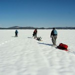 Dragging supplies on sleds to our site in Ossipee Lake